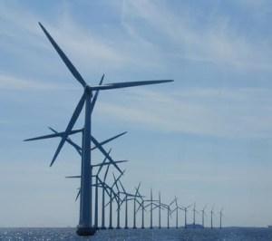Berinvestasi untuk membangun pembangkit tenaga listrik bertenaga kincir angin